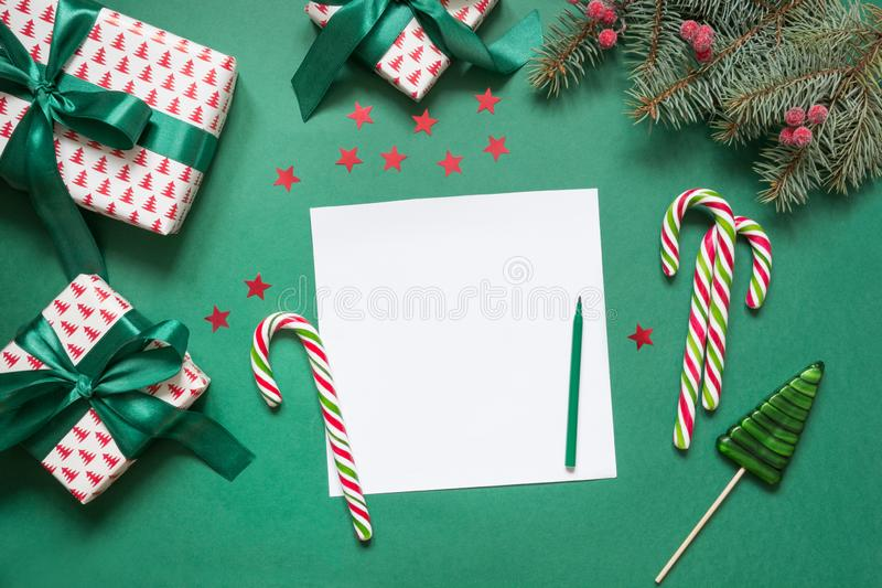 Christmas empty blank letter to Santa or invitation on green. Top view. With copy space royalty free stock photography