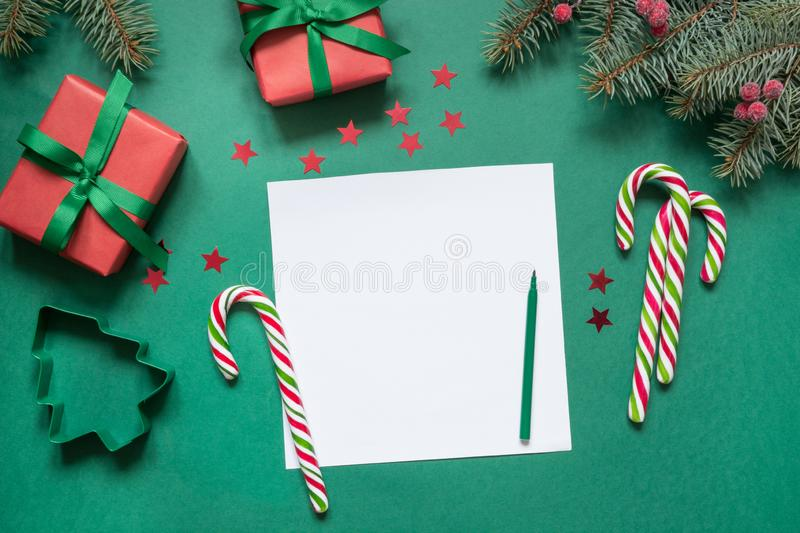 Christmas empty blank letter to Santa or invitation on green. Top view. With copy space. Xmas holiday royalty free stock photography