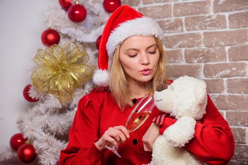 Christmas eve. Alone at home. Lonely woman with teddy bear toy and champagne glass christmas eve. Nostalgic moments stock images