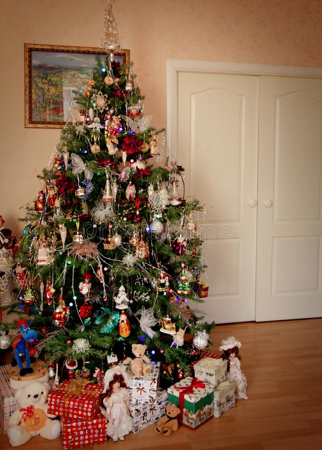 Christmas eve: beautifully decorated christmas tree with toys and presents royalty free stock images