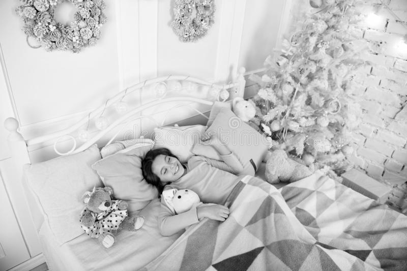 Christmas eve concept. Child waiting christmas in bedroom. Kid lay in bed relaxing. Home is the best place in the world stock images