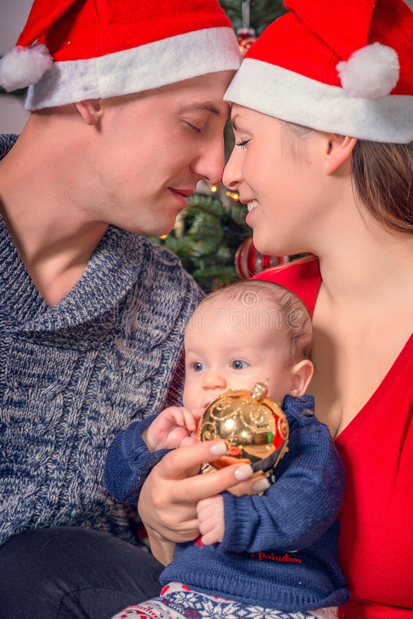 Christmas eve family. Christmas family at home on eve stock photos