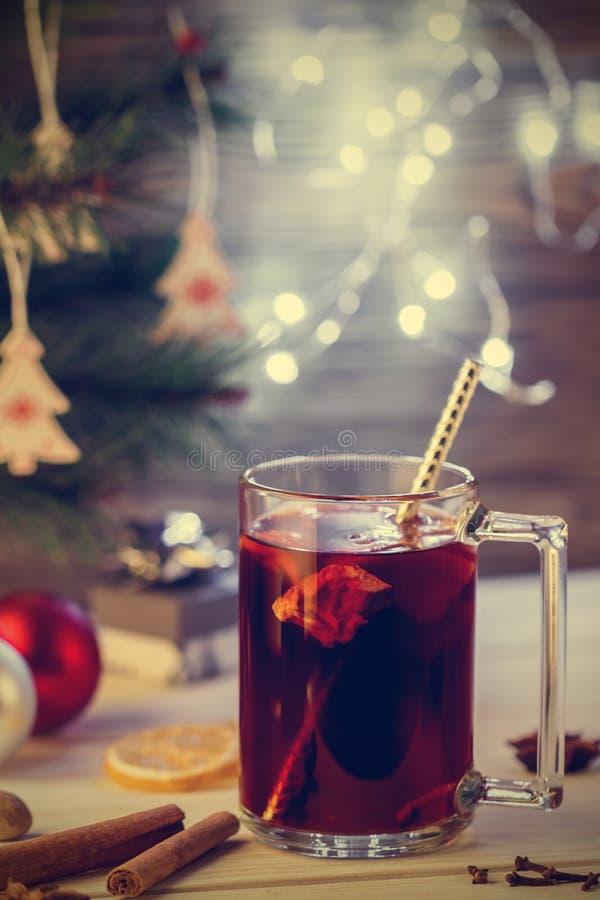 Christmas Eve. Hot drink mulled wine, Christmas background. Effect toned image. stock image