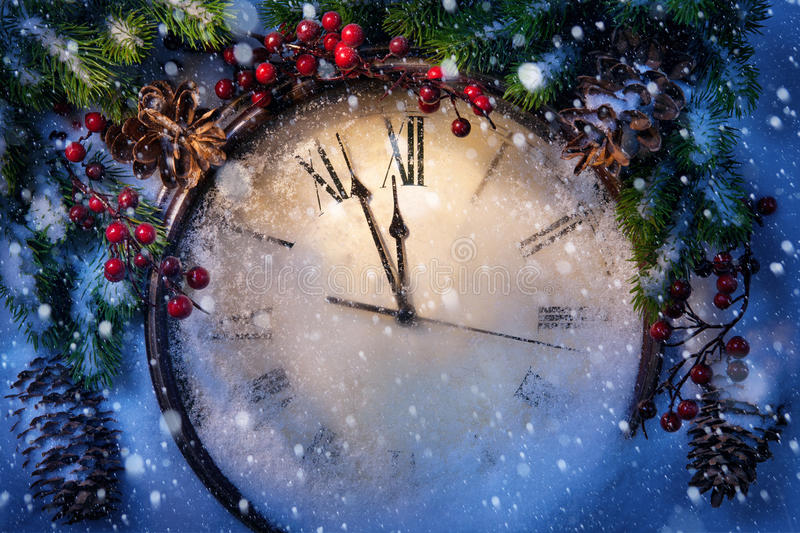 Christmas Eve and New Years at midnight stock photos