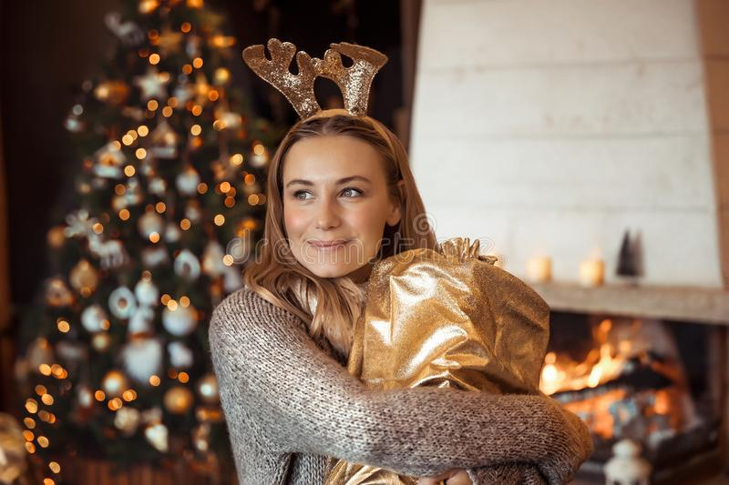 Happy girl with Christmas gift stock images