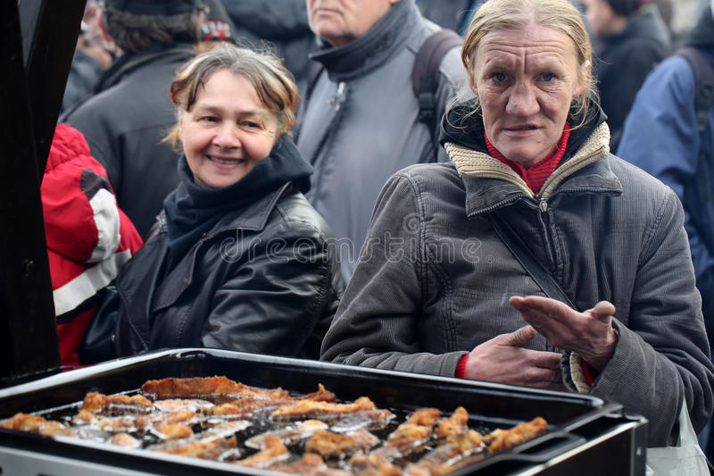 Christmas Eve for poor and homeless. On the Central Market in Cracow. Every year the group Kosciuszko prepares the greatest eve in the open air in Poland stock photography
