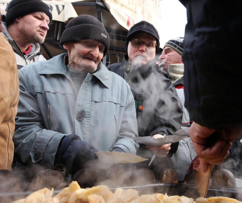 Christmas Eve for poor and homeless on the Central Market in Cracow stock photos