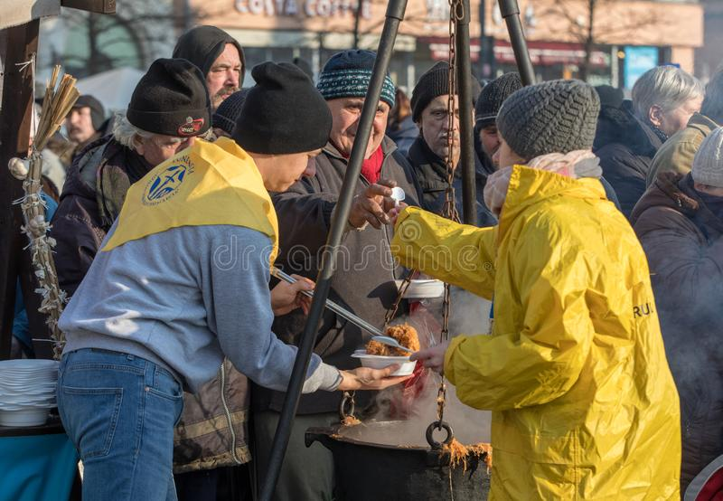 Christmas Eve for poor and homeless on the Main Square in Cracow. Cracow, Poland - December 17, 2017: Christmas Eve for poor and homeless on the Main Square in royalty free stock images