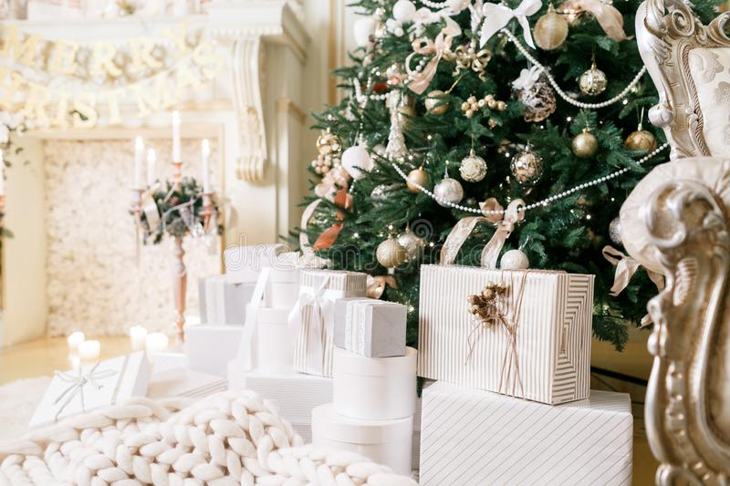 Classic apartments. Many Christmas gifts under tree royalty free stock photo