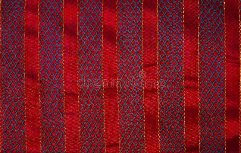 Christmas Fabric Background Red Stripes Embroidered. Fabric background in red with gold trim embroidered mesh pattern stock photos