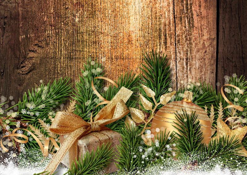 Christmas fabulous decoration on grunge wooden background. Christmas decoration with ball, holly and presents on a grungy wooden background. With a place for stock photos