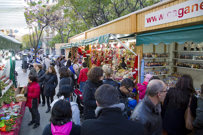Christmas fair in Barcelona. People visit the famous Santa Llucia Fair near Sagrada Familia cathedral to buy Christmas decoration, as fir trees and crib figures stock image