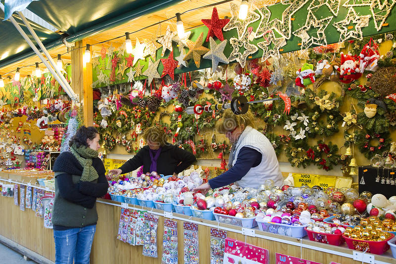 Christmas fair in Barcelona. People visit the famous Santa Llucia Fair near Sagrada Familia cathedral to buy Christmas decoration, as fir trees and crib figures royalty free stock photo
