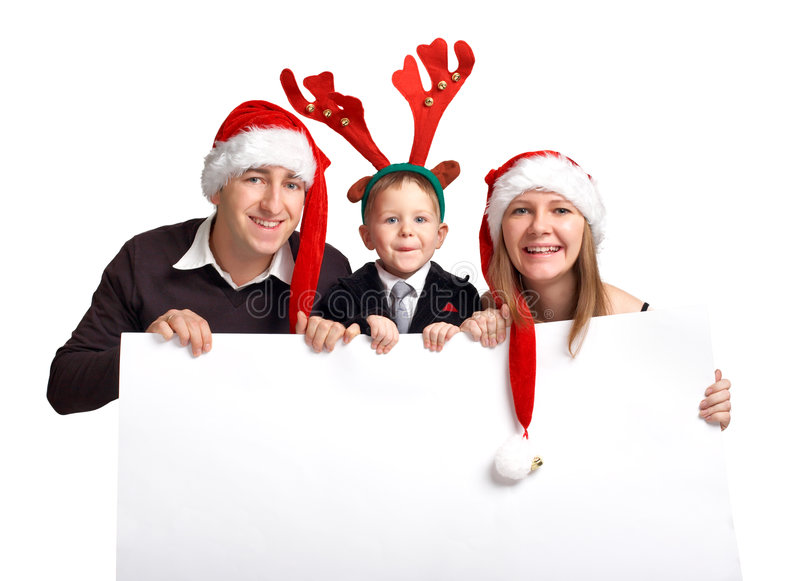 Christmas family with banner. Happy family of three in Christmas hats holds white banner royalty free stock images