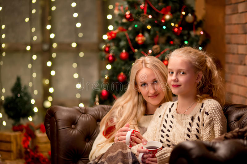 Christmas and family concept - mother and daughter royalty free stock photography