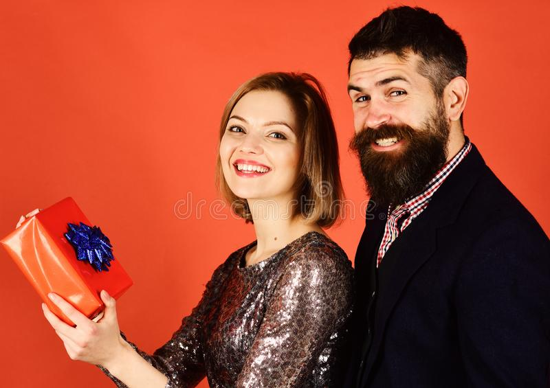 Christmas family and dating concept. Girl and bearded man. Christmas family and dating concept. Girl and bearded men with cheerful faces and red gift box royalty free stock photos