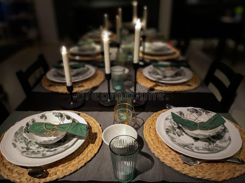 Christmas Family Dinner Concept. Dinner table setting by candlelight, Christmas Family Dinner Concept royalty free stock image