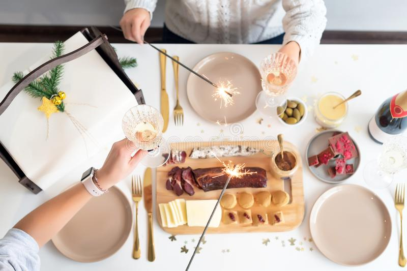 Christmas Family Dinner Table Concept. Christmas feast. Holiday Gold place setting, overhead shoot. Christmas Family Dinner Table Concept. Christmas feast royalty free stock photo