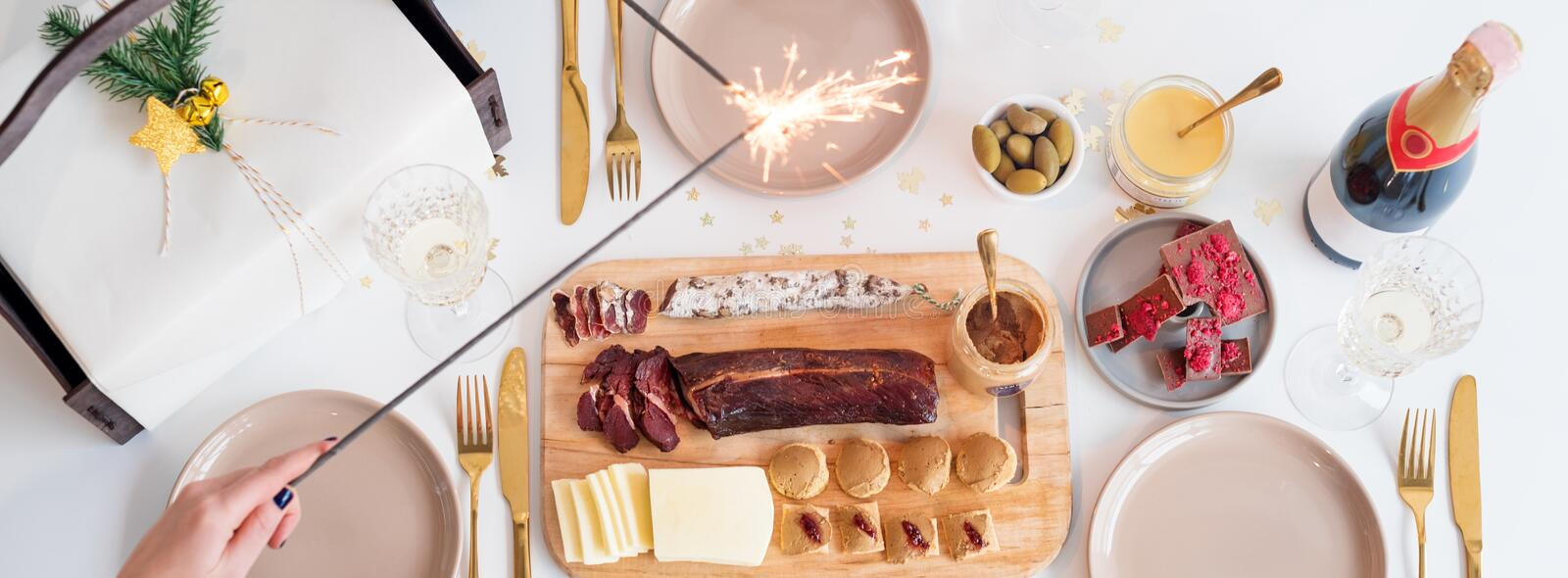 Christmas Family Dinner Table Concept. Christmas feast. Holiday Gold place setting, overhead shoot. Christmas Family Dinner Table Concept. Christmas feast royalty free stock image