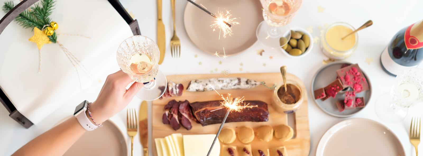 Christmas Family Dinner Table Concept. Christmas feast. Holiday Gold place setting, overhead shoot. Christmas Family Dinner Table Concept. Christmas feast stock photo