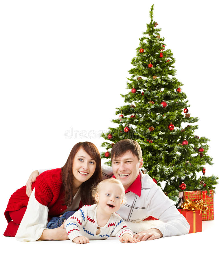 Christmas family funy baby under fir tree over white background. Christmas family funy baby lying under fir tree isolated over white background royalty free stock photos