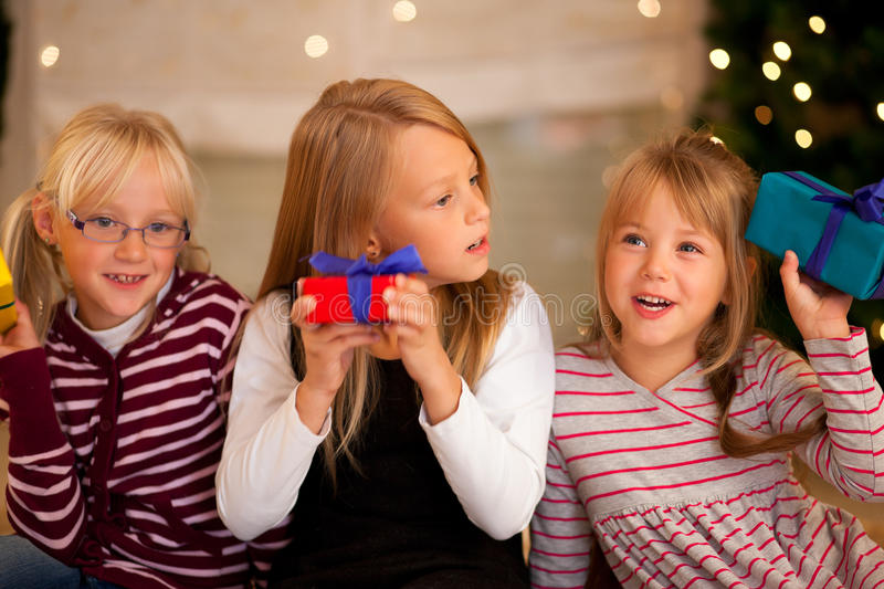 Download Christmas And Family - Girls With Presents Stock Photo - Image: 16695534