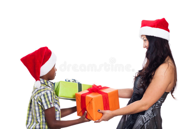 Christmas family giving presents. Happy Christmas family giving presents, isolated on white background royalty free stock photos