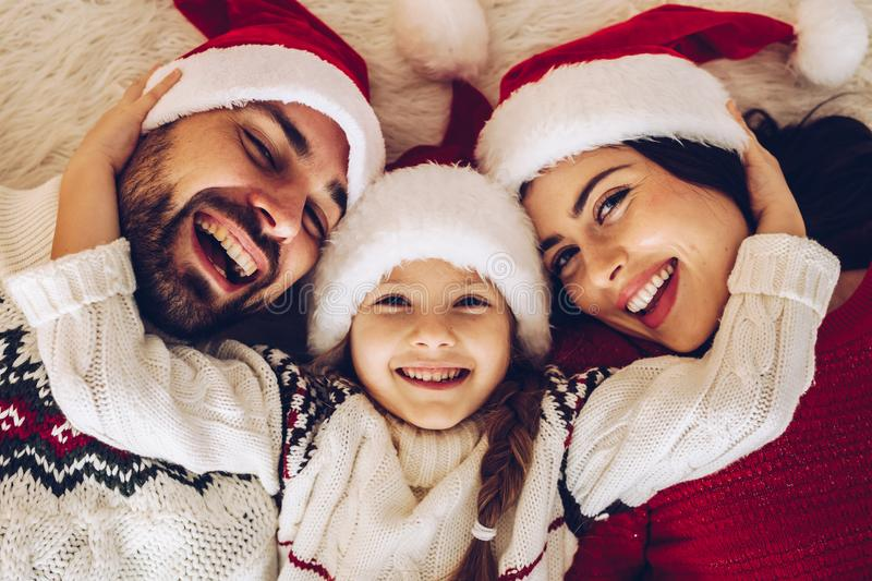 Christmas family! Happy mom, dad and little daughter on Santa Cla royalty free stock images
