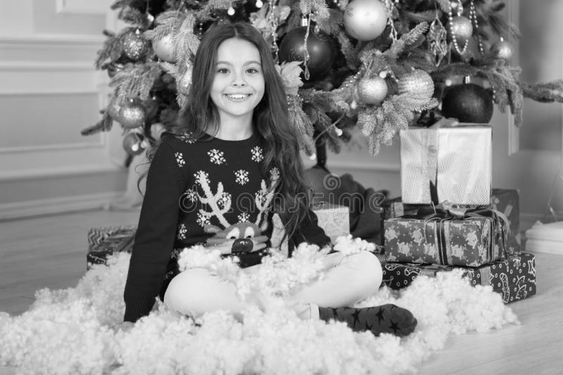 Christmas family holiday. happy new year. Christmas shopping. The morning before Xmas. Cute little child girl with xmas. Present. waiting for santa. Xmas stock image