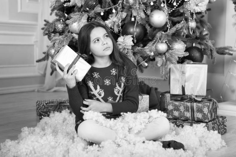 Christmas family holiday. happy new year. Christmas shopping. waiting for santa. Xmas. The morning before Xmas. Cute. Little child girl with xmas present. what stock photo