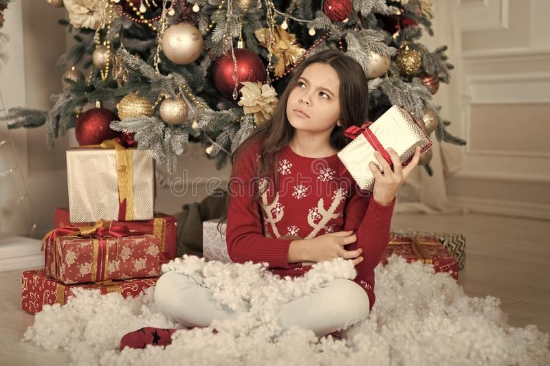 Christmas family holiday. happy new year. Christmas shopping. waiting for santa. Xmas. The morning before Xmas. Cute. Little child girl with xmas present. what royalty free stock photography