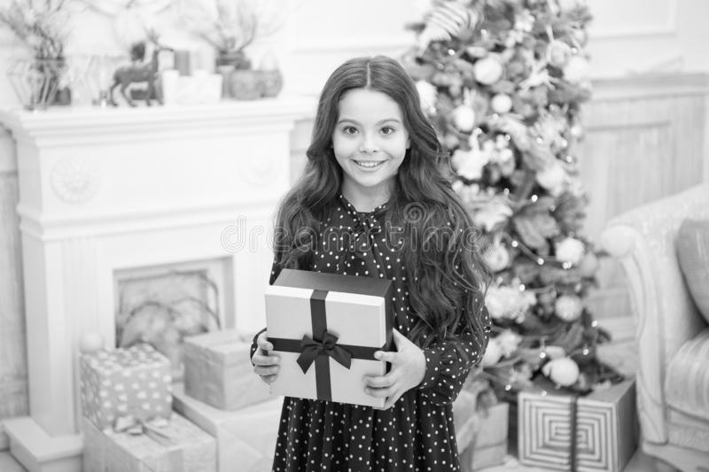 Christmas family holiday. happy new year. Christmas shopping. Cute little child girl with xmas present. The morning. Before Xmas. waiting for santa. Winter royalty free stock images
