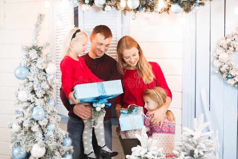 Christmas family open present gift bag, Christmas tree interior.  royalty free stock photos