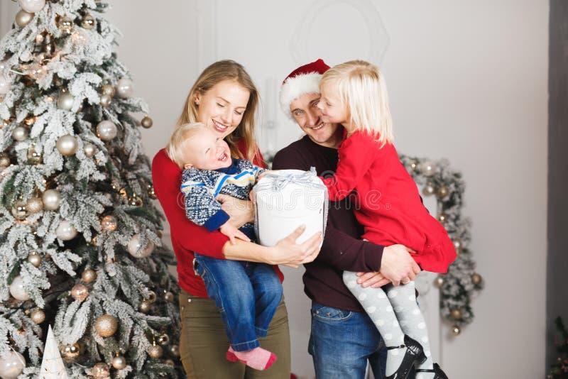 Christmas family open present gift bag, Christmas tree interior.  royalty free stock photography