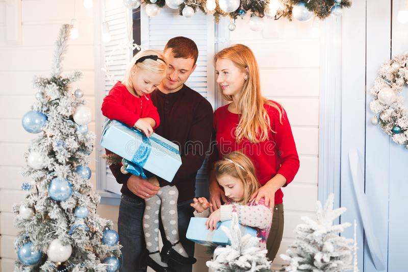 Christmas family open present gift bag, Christmas tree interior.  royalty free stock images