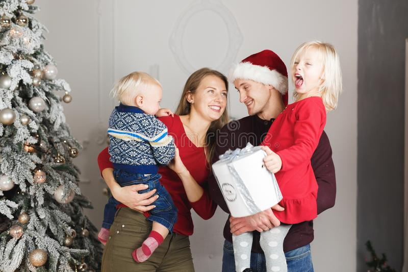 Christmas family open present gift bag, Christmas tree interior.  stock photo