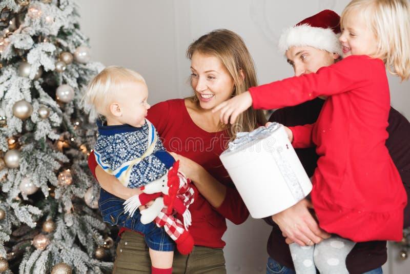 Christmas family open present gift bag, Christmas tree interior.  stock photography