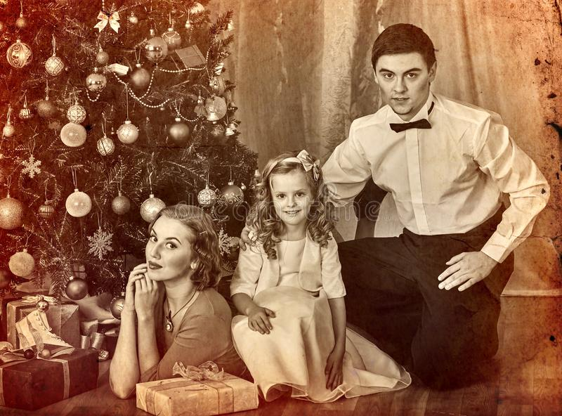 Christmas family photo with mother father girl. Black and white stock photos