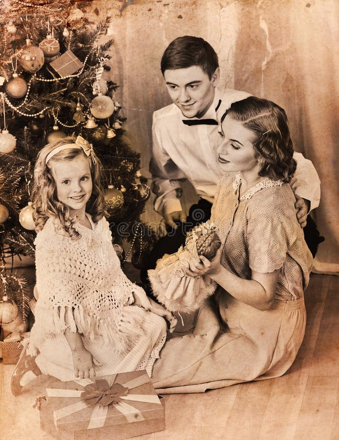 Christmas family photo with mother father girl. Black and white. Christmas family photo with mother, father and girl. Black and white Xmas vintage image with stock image