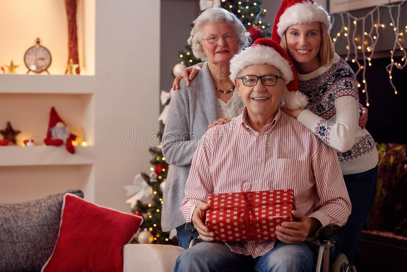 Christmas family portrait of daughter with elderly parents. Christmas family portrait of smiling daughter with elderly parents stock photos