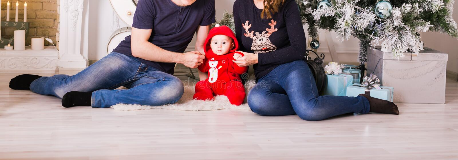Christmas Family Portrait In Home Holiday Living Room, Present Gift Box, House Decorating By Xmas Tree Candles Garland stock photography
