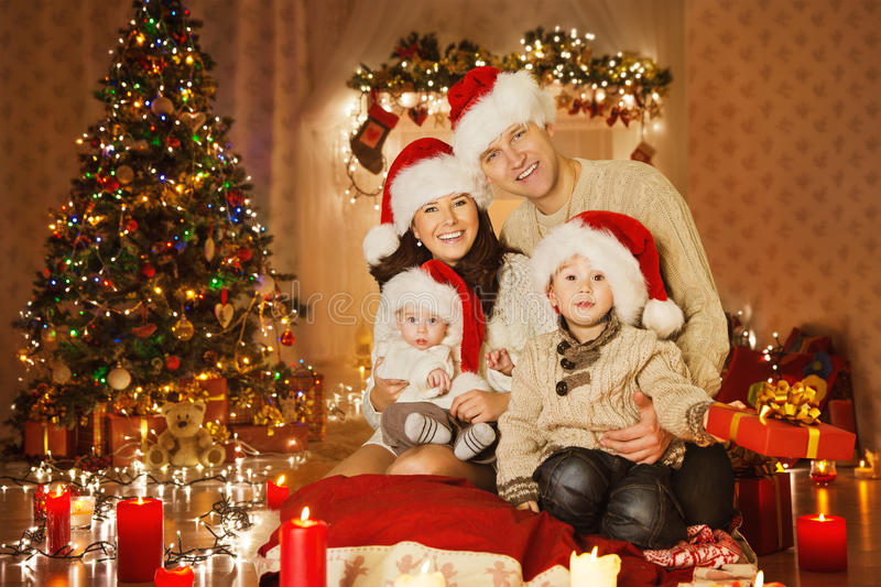 Download christmas family portrait in home holiday room at santa hat stock photo image