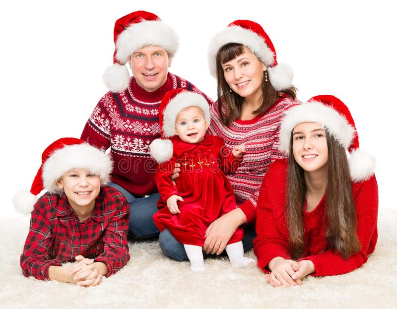 Christmas Family Portrait, Parents and Children in Red Santa Hats, Five Persons on White. Christmas Family Portrait, Parents and Children in Red Santa Hats, Five royalty free stock images