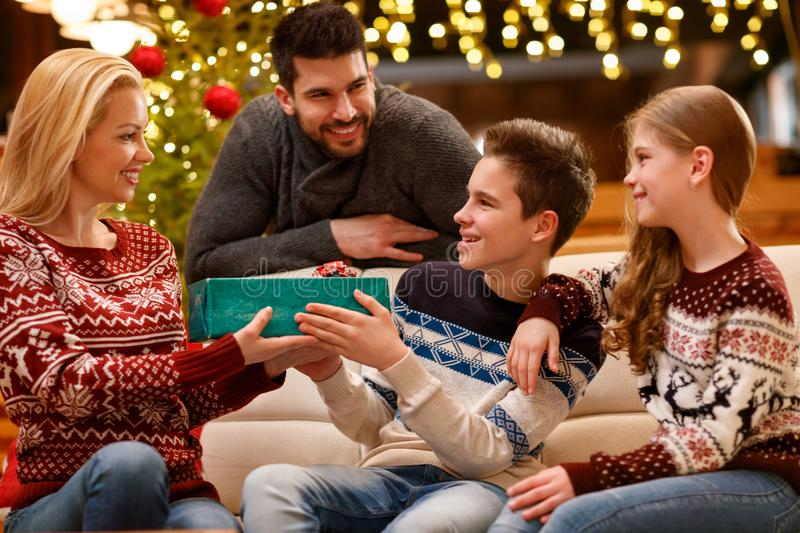 Christmas family together, son give gift to mother. Happy Christmas family together, son give gift to her mother royalty free stock photo