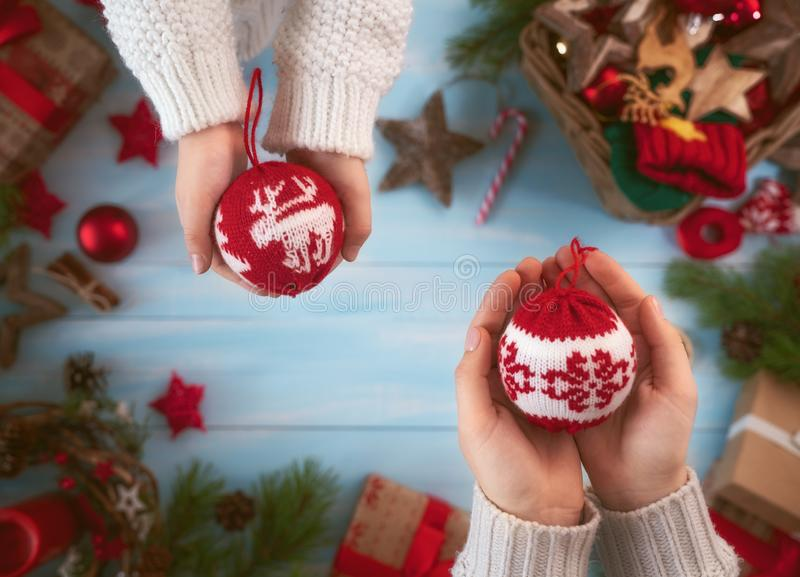 Christmas Family traditions. Merry Christmas and Happy Holidays! A mother and daughter preparing Xmas gifts. Baubles, presents, candy with ornaments. Top view royalty free stock photos