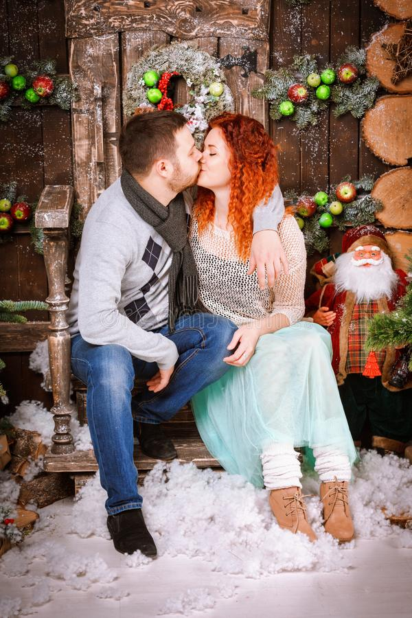 Christmas happy family of two persons and fir tree with gift boxes new year winter decorated background. Christmas family of two persons mother father young stock photos