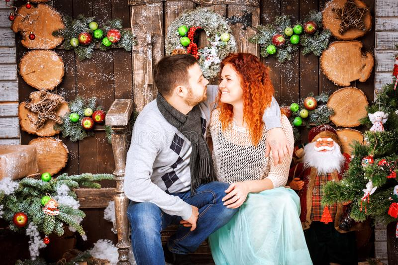 Christmas happy family of two persons and fir tree with gift boxes new year winter decorated background. Christmas family of two persons mother father young stock image