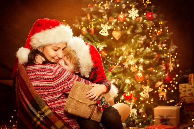 Christmas Family and Xmas Tree, Happy Mother give Baby Child New Year Present Gift. Christmas Family and Xmas Tree, Happy Mother give Baby Child with New Year stock photo