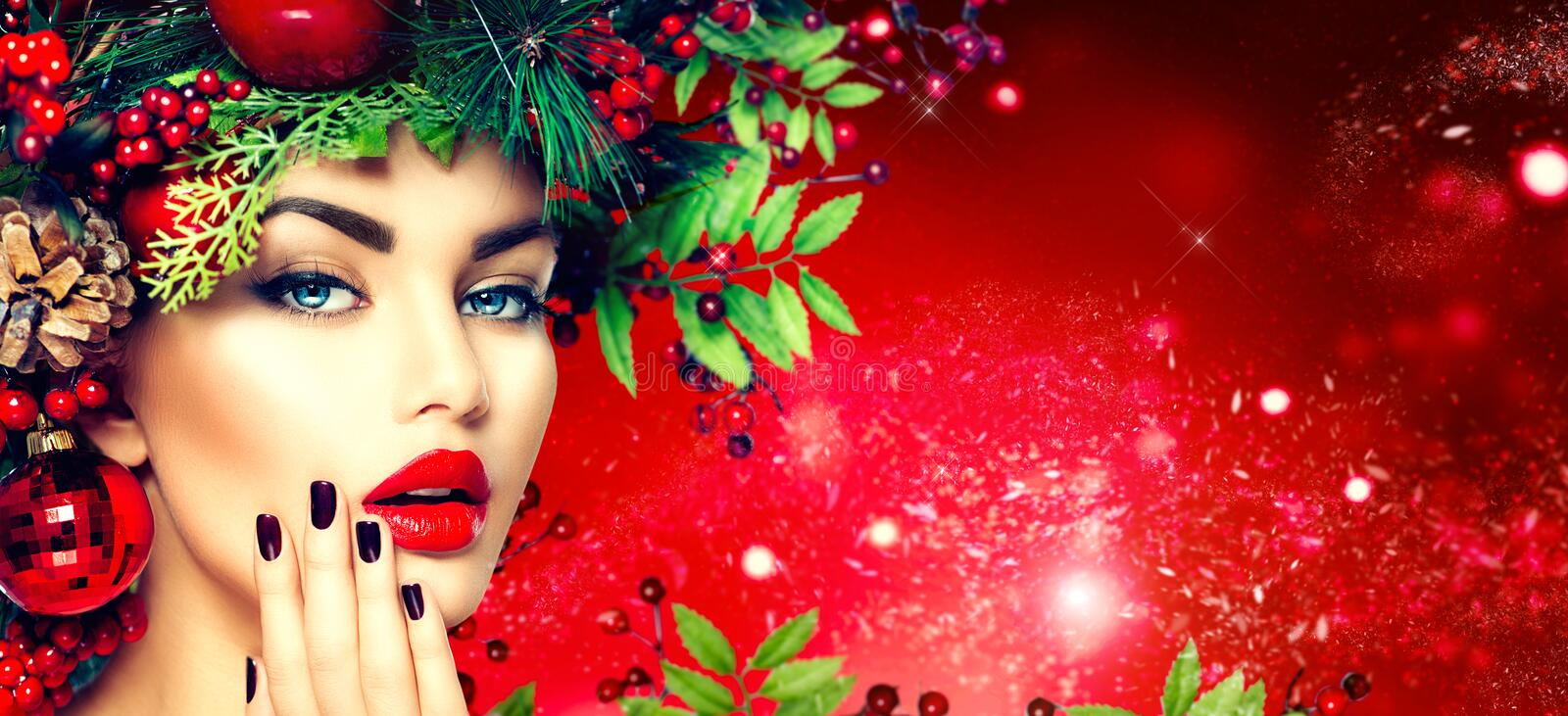 Christmas fashion woman. Holiday hairstyle and makeup. Christmas fashion model woman. Holiday hairstyle and makeup stock photos