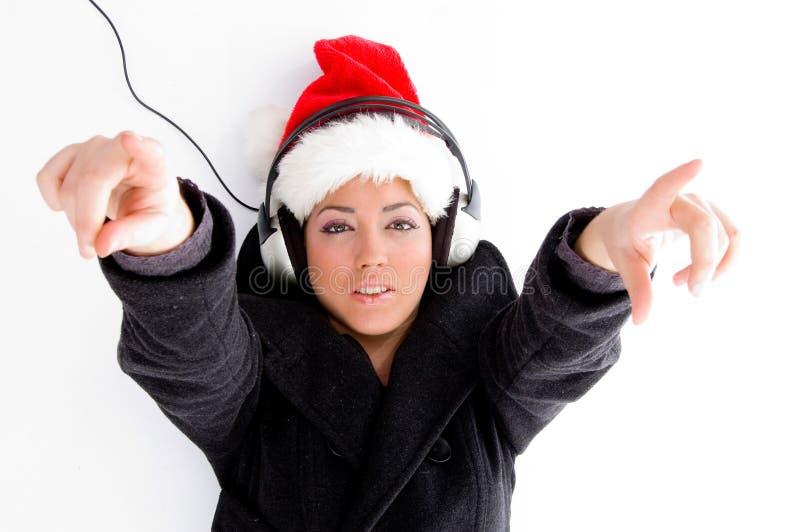 christmas female hat pointing wearing fotografering för bildbyråer